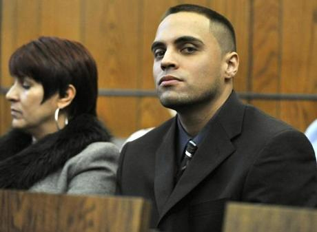 Angel Ortiz, in court with his mother, Chelsea housing manager Jacqueline Matos, lived for a time in a subsidized unit.